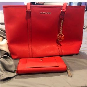 Michael Kors orange handbag with matching wallet